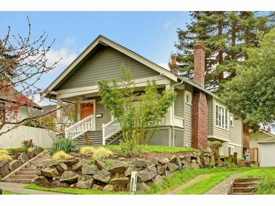 Moving up to $649,950, here's 1817 N. 49th St. The 2,200-square-foot Craftsman, built in 1914, built in 1914, has four bedrooms, two bathrooms, built-ins, a lower-level media room, a front porch and a back deck on a 4,083-square-foot lot. Photo: Courtesy Samson Asfaw, Windermere Real Estate