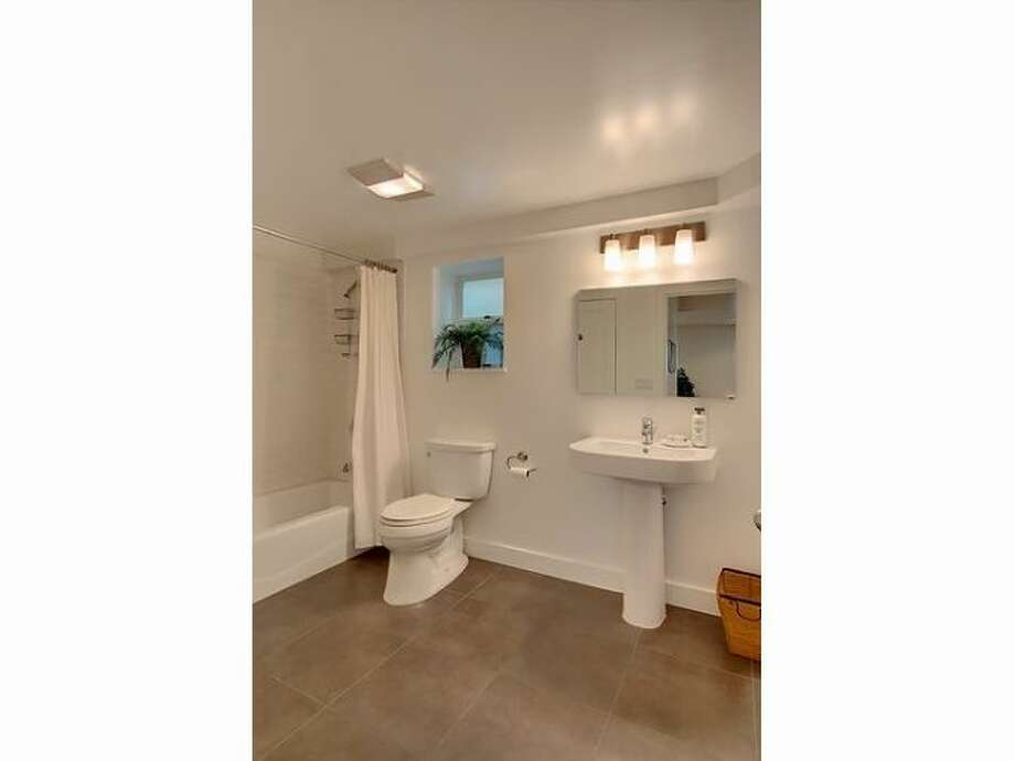 Bathroom of 1817 N. 49th St. The 2,200-square-foot Craftsman, built in 1914, built in 1914, has four bedrooms, two bathrooms, built-ins, a lower-level media room, a front porch and a back deck on a 4,083-square-foot lot. It's listed for $649,950. Photo: Courtesy Samson Asfaw, Windermere Real Estate