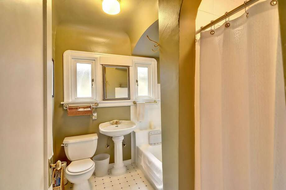 Bathroom of 4732 4th Ave. N.E. The 3,160-square-foot brick Tudor, built in 1928, has four bedrooms, 1.75 bathrooms, coved ceilings, exposed wood moldings, a family room and a finished basement on a 4,080-square-foot lot. It's listed for $650,000. Photo: Courtesy Alise Roberts, RE/MAX Performance Plus