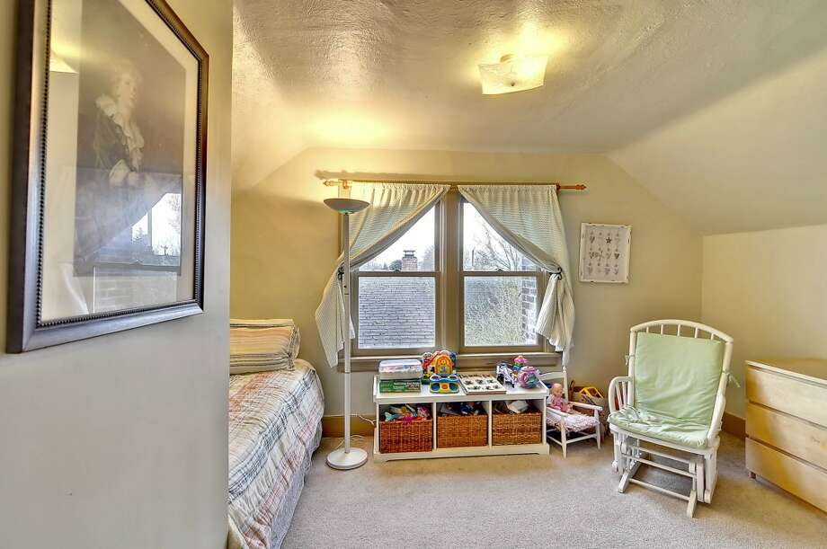 Bedroom of 4732 4th Ave. N.E. The 3,160-square-foot brick Tudor, built in 1928, has four bedrooms, 1.75 bathrooms, coved ceilings, exposed wood moldings, a family room and a finished basement on a 4,080-square-foot lot. It's listed for $650,000. Photo: Courtesy Alise Roberts, RE/MAX Performance Plus