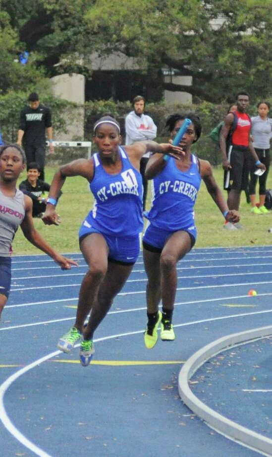 Cy Creek's Daina Harper (left) takes a handoff from Jasmine Lewis in the 400-meter relay. District 17-5A girls champion Cy Creek will compete in an area meet hosted by the Klein ISD on Friday, April 19. Photo: L. Scott Hainline / Freelance