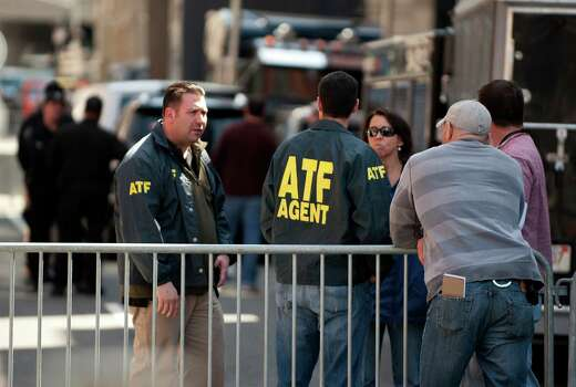 Alcohol, Tobacco and Firearms (ATF) officers confer near the finish line of the Boston Marathon on April 16, 2013, where two explosions struck the Boston Marathon on April 15. The explosives used in the Boston Marathon bombings were likely homemade devices full of nails and metal fragments designed to cause widespread injury, according to initial reports. A day after an attack that left three dead and more than 170 wounded, the FBI and Boston police declined to reveal details of their probe, or whether they suspected the assault was linked to foreign or domestic extremists. Photo: DON EMMERT, Getty Images / 2013 AFP