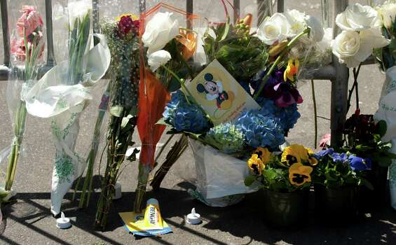 A tube of Bengay, a pain relief medecine, lays nears flowers at a memorial site at Boylston and Arlington streets along the course of the Boston Marathon on April 16, 2013, a few blocks from where two explosions struck near the finish line of the Boston Marathon on April 15. The explosives used in the Boston Marathon bombings were likely homemade devices full of nails and metal fragments designed to cause widespread injury, according to initial reports. A day after an attack that left three dead and more than 170 wounded, the FBI and Boston police declined to reveal details of their probe, or whether they suspected the assault was linked to foreign or domestic extremists. Photo: DON EMMERT, Getty Images / 2013 AFP