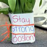 Flowers and a message are left on Newbury Street April 16, 2013 in Boston, Massachusetts, a few blocks from where two explosions struck near the finish line of the Boston Marathon on Monday. Three people, including a child, were killed and more than 170 were injured in the explosions that occurred a few seconds apart near the finish line of the 117th rendition of the world's oldest international marathon
