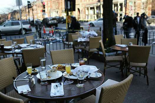 The unfinished meals of fleeing customers are left on tables at an outdoor restaurant near the scene of a twin bombing at the Boston Marathon on April 16, 2013 in Boston, Massachusetts. The twin bombings, which occurred near the marathon finish line, resulted in the deaths of three people while hospitalizing at least 128. The bombings at the 116-year-old Boston race, resulted in heightened security across the nation with cancellations of many professional sporting events as authorities search for a motive to the violence. Photo: Spencer Platt, Getty Images / 2013 Getty Images