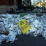 Unused thermal blankets for marathon participants are piled near the scene of a twin bombing at the Boston Marathon on April 16, 2013 in Boston, Massachusetts. The twin bombings, which occurred near the marathon finish line, resulted in the deaths of three people while hospitalizing at least 128. The bombings at the 116-year-old Boston race, resulted in heightened security across the nation with cancellations of many professional sporting events as authorities search for a motive to the violence.