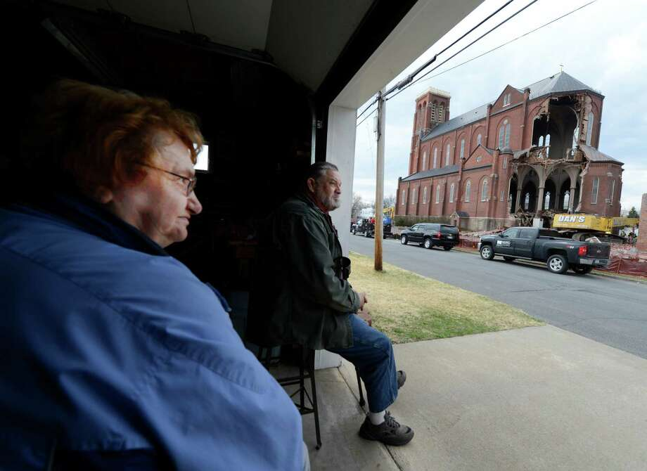 Pat LaBarge, left and John Timberlin watch the demolition of St. Patrick's Church this morning April 16, 2013 in Watervliet, N.Y.    (Skip Dickstein/Times Union) Photo: SKIP DICKSTEIN / 10021994A