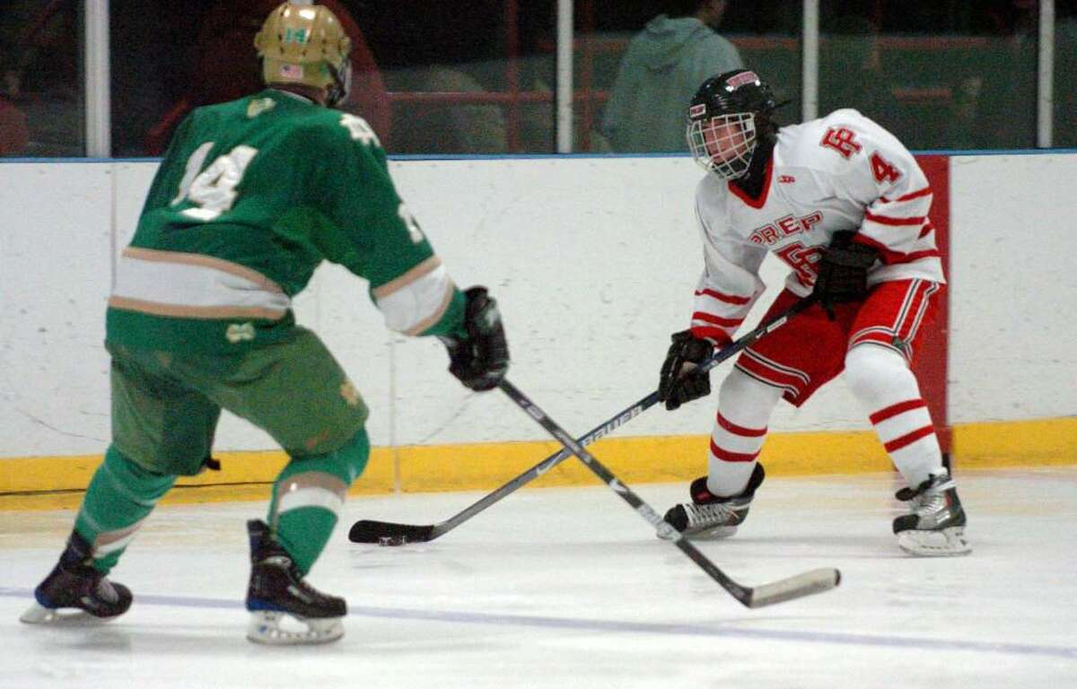 Fairfield Prep's #4 Scotty Bialczak, right, comes up against Notre Dame's #14 Kevin Dubrow, during hockey action at the Wonderland of Ice in Bridgeport, Conn. on Wednesday Jan. 06, 2010.