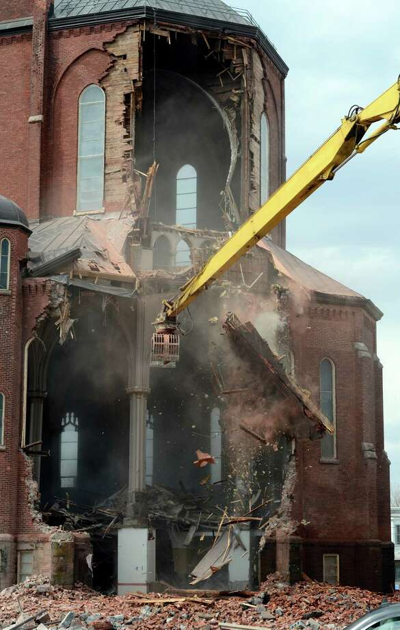 The demolition of St. Patrick's Church this morning April 16, 2013 in Watervliet, N.Y.    (Skip Dickstein/Times Union) Photo: SKIP DICKSTEIN / 10021994A