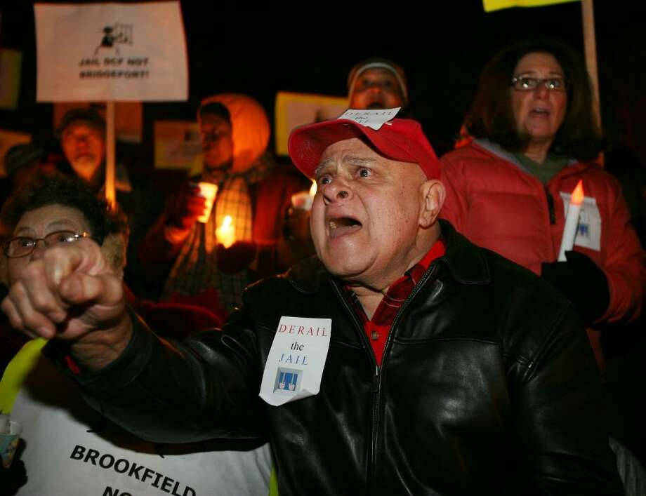 Tony Carbone, a resident of Louisiana Avenue in Bridgeport since 1941, shouts out his anger at a rally against the proposed detention center on Virginia Avenue in Bridgeport, Wednesday night. Photo: Brian A. Pounds / Connecticut Post