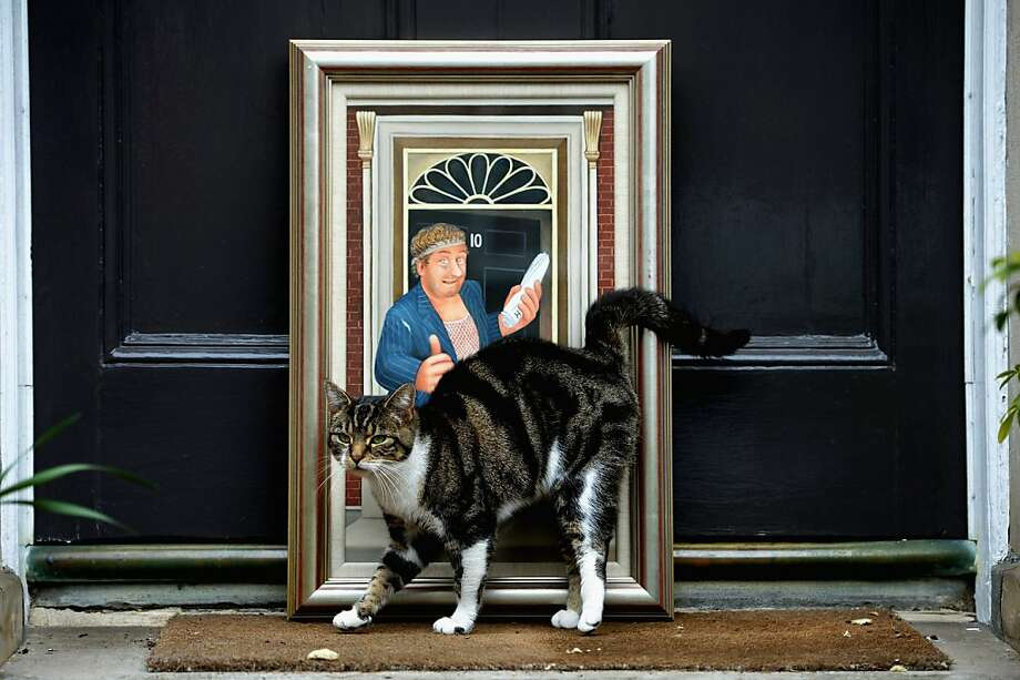Rubbing Rab: A painting by artist Beryl Cook of British sitcom character Rab C. Nesbitt standing outside 10 Downing Street was expected to fetch between $9,000 and $12,000 at auction in Edinburgh, Scotland. Now probably closer to $9,000 due to the cat hair. Photo: Jeff J Mitchell, Getty Images