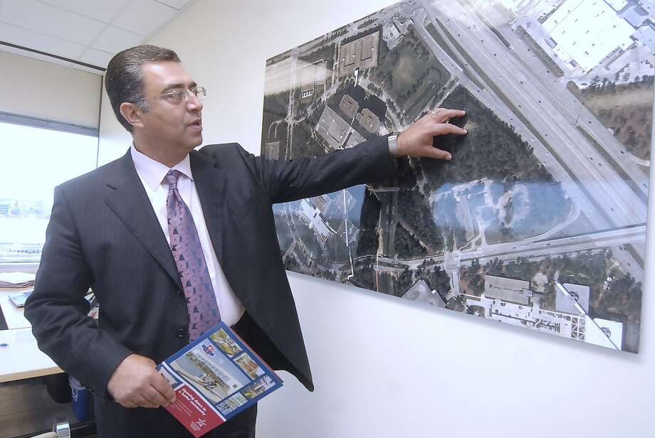 Shah Ardalan, Lone Star College-University Park president, points out where two new buildings would have been built if the bond issue had been approved. Photo: Â Tony Bullard 2013, Freelance Photographer / © Tony Bullard & the Houston Chronicle