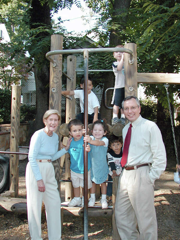 Greenwich philanthropist and Family Centers Chairman Anne Firestone Ball poses with Family Centers President Bob Arnold and preschoolers in 2004. Photo: Contributed Photo