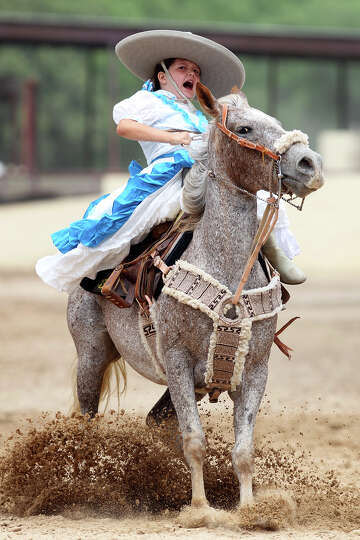 A young escaramuza charra performs during the Fiesta Charreada at the San Antonio Charro Ranch, Sund