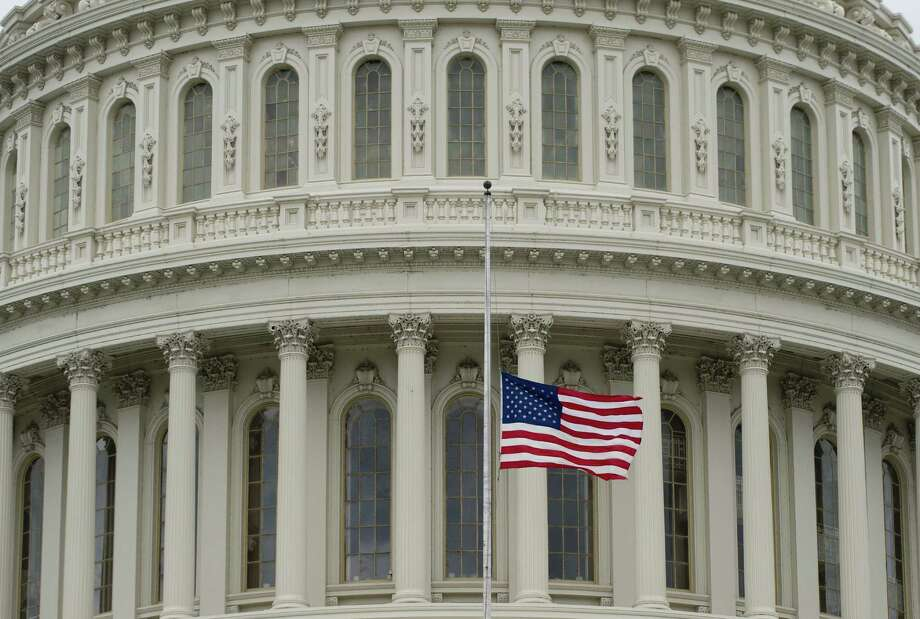 The U.S. flag flies over the U.S. Capitol Tuesday in honor of the three people killed in the bombings at the Boston Marathon. Photo: Saul Loeb / AFP / Getty Images