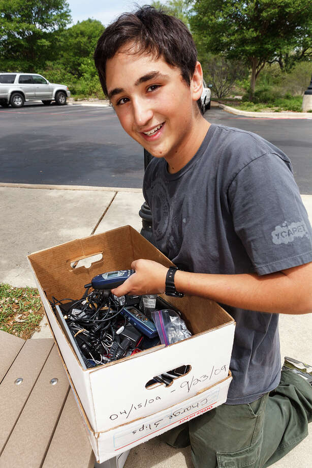 Chris Lira of Boy Scout Troop 496 hold a box of used cell phones collected during his second annual electronic waste drive with Alied Waste, to celebrate Earth Day, at Shavano Park City Hall on Saturday, April 13, 2013.  Shavano Park residents were invited to bring their old electronics for recycling or repurposing, documents to be shredded and old cell phones that could be refurbished, cleared of all memory, and bi en to the Battered Women and Children's Shelter of San Antonio.  Photo by Marvin Pfeiffer / Prime Time Newspapers Photo: MARVIN PFEIFFER, Marvin Pfeiffer / Prime Time New / Prime Time Newspapers 2013