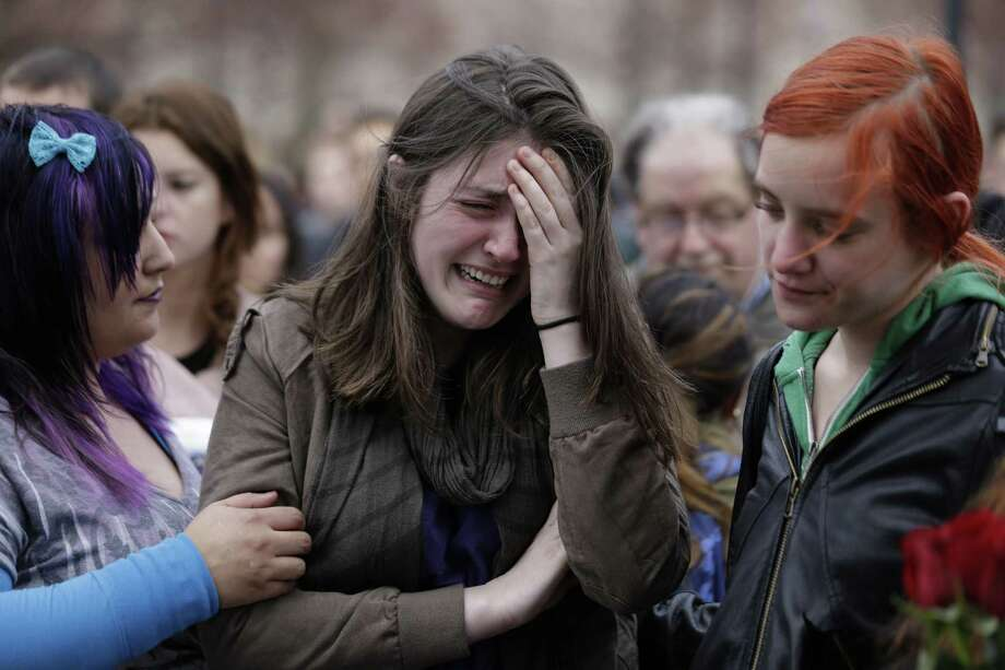 Tears flow at a vigil for the  victims of the Boston Marathon explosions.  How do we learn to not grow accustomed to terrorism?