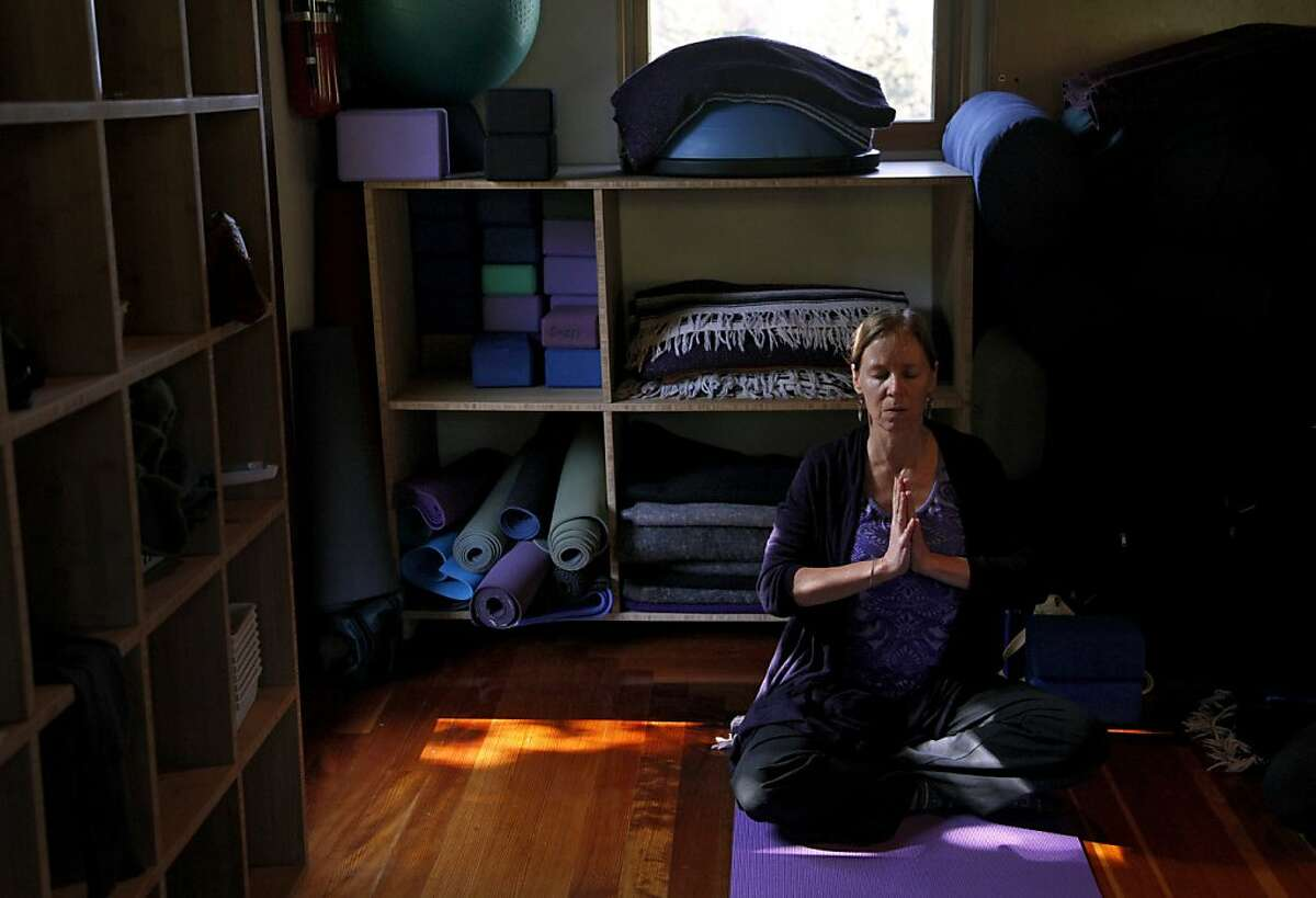 Cathy Harrington focuses on breathing during a class at Shakti Yoga Shala in Boulder Creek, Calif., on Friday, April 12, 2013.