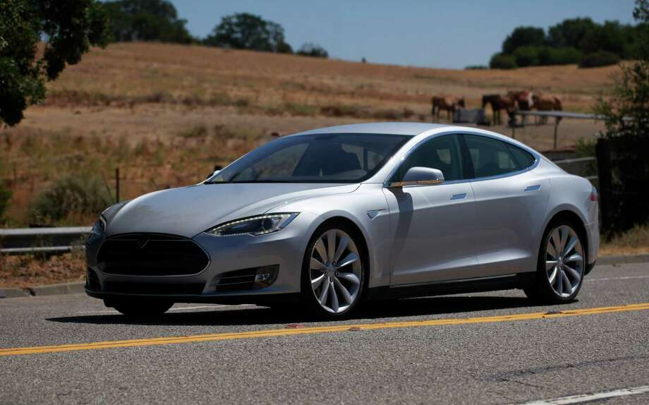 The all-electric Tesla Model S was named 2013 car of the Year by Motortrend magazine. A Model S will be on display at during an electric-car rally and showcase April 27 at the Saugatuck train station. Photo: Mike Kepka, The Houston Chronicle / ONLINE_YES