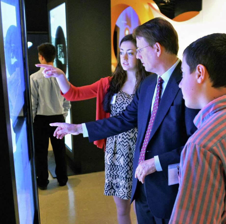 IBM's Rod Rahe with Tech Valley High students Grace White, left, 18, of Schenectady, and Gary Peck, at right, 15, of Cobleskill at the opening of THINK, an IBM exhibit at the museum of innovation and science ( formerly the Schenectady museum) in Schenectady, NY Tuesday April 16, 2013.  (John Carl D'Annibale / Times Union) Photo: John Carl D'Annibale / 10021988A