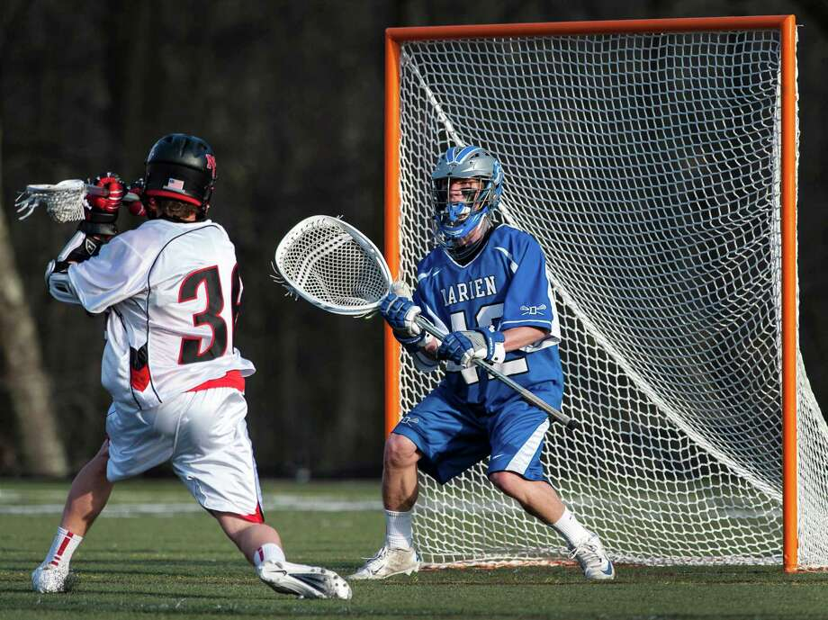 New Canaan high school's Michael Kraus winds up to take a shot on Darien high school goalie Phil Huffard in a boys lacrosse game played at New Canaan high school, New Canaan CT on Tuesday April 16th, 2013. Kraus scored a goal on this shot. Photo: Mark Conrad / Stamford Advocate Freelance