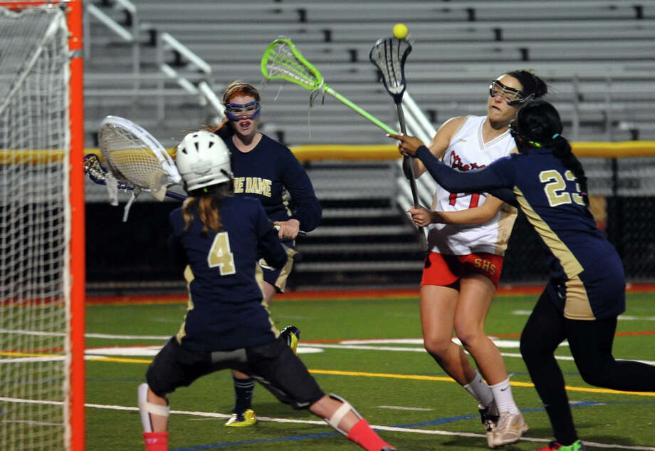 Stratford's Sarah Horelik sends the ball towards the net as Notre Dame of Fairfield goalie Bayley McKeon goes to block, during girls lacrosse action in Stratford, Conn. on Tuesday April 16, 2013. Horelik scored in this attempt. Photo: Christian Abraham / Connecticut Post
