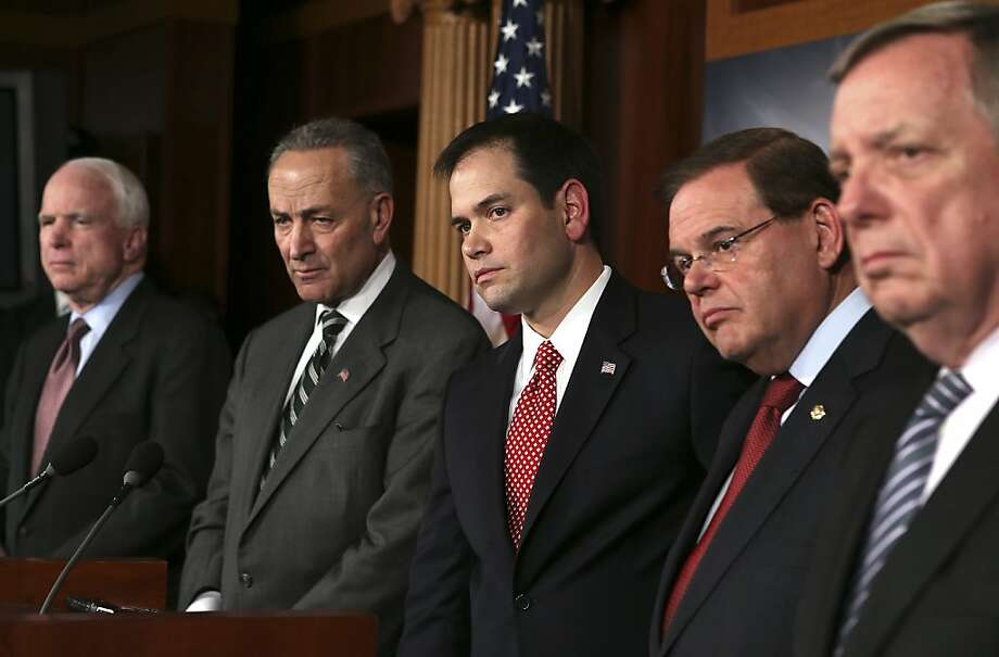 Senators working on the immigration bill - John McCain, R-Ariz., Chuck Schumer, D-N.Y., Marco Rubio, R-Fla., Robert Menendez, D-N.J., and Dick Durbin, D-Ill. - are seen in January. Photo: Doug Mills, New York Times