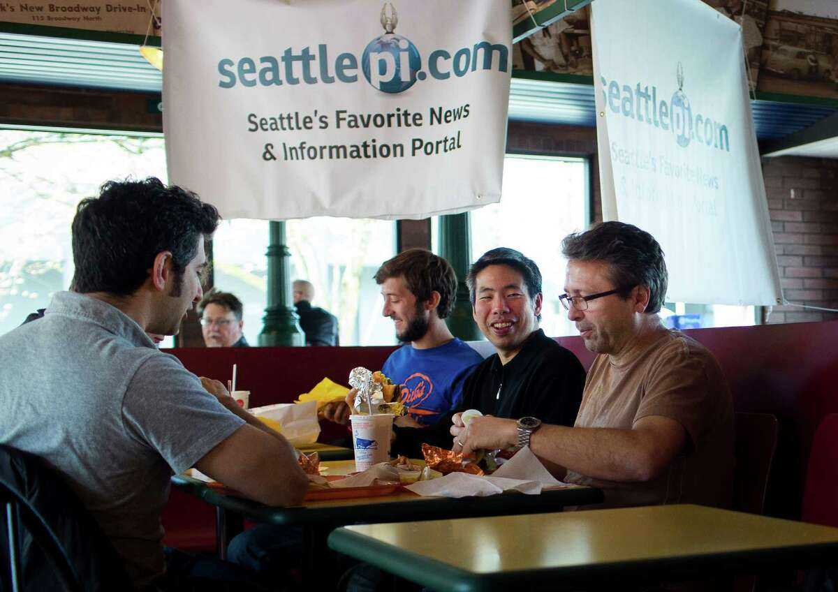 Customers enjoy their free food during a seattlepi.com promotional event at the Queen Anne Dick's Drive-In.