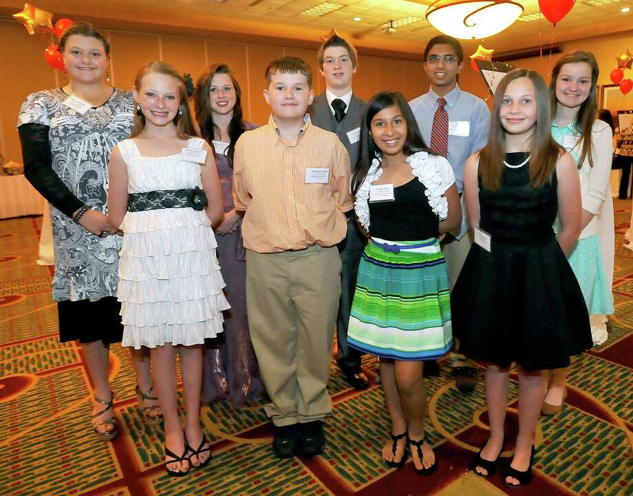 The 2nd Annual Better Business Bureau of Southeast Texas Laws of Life awards banquet was held Tuesday night April 16, 2013 at the Holiday Inn at Walden Road. There were ten finalists in the essay contest.  From left, top row; Sable Reynolds from Orangefield Junior High School, Abigail LaCouture from Vidor Junior High School, Cole Coulter from Orangefield Junior High School, Bassam Syed from Marshall Middle School, and Emily Jones from Marshall Middle School.  On the bottom row from the left, Kayla Campbell from Silsbee Middle School, Nicholas Lewis from Vidor Middle School, Shelby Euton from Port Neches Middle School, and Avery Jagoe from Vincent Middle School. Dave Ryan/The Enterprise Photo: Dave Ryan