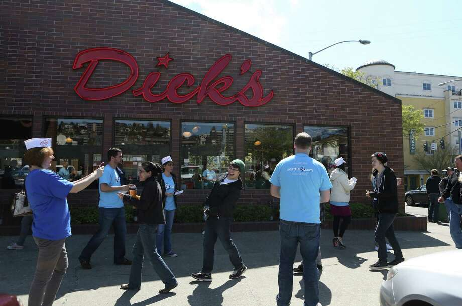 Customers line up outside the Queen Anne Dick's Drive-In during a seattlepi.com promotion. Between 2 and 4 p.m. the P-I treated customers to free food with $2 gift certificates for every customer that came to the business. The event was a thank you to readers. Photo: JOSHUA TRUJILLO, SEATTLEPI.COM / SEATTLEPI.COM