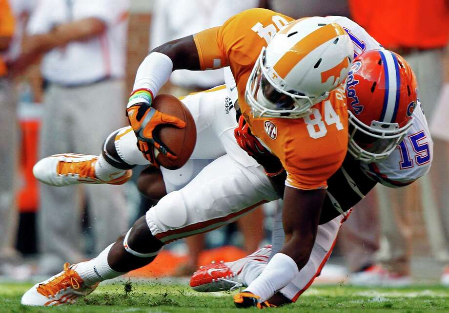 Tennessee wide receiver Cordarrelle Patterson (84) is tackled by Florida defensive back Loucheiz Purifoy (15) in the first quarter of an NCAA college football game, Saturday, Sept. 15, 2012, in Knoxville, Tenn. (AP Photo/Wade Payne) Photo: Wade Payne, FRE / FR23601 AP