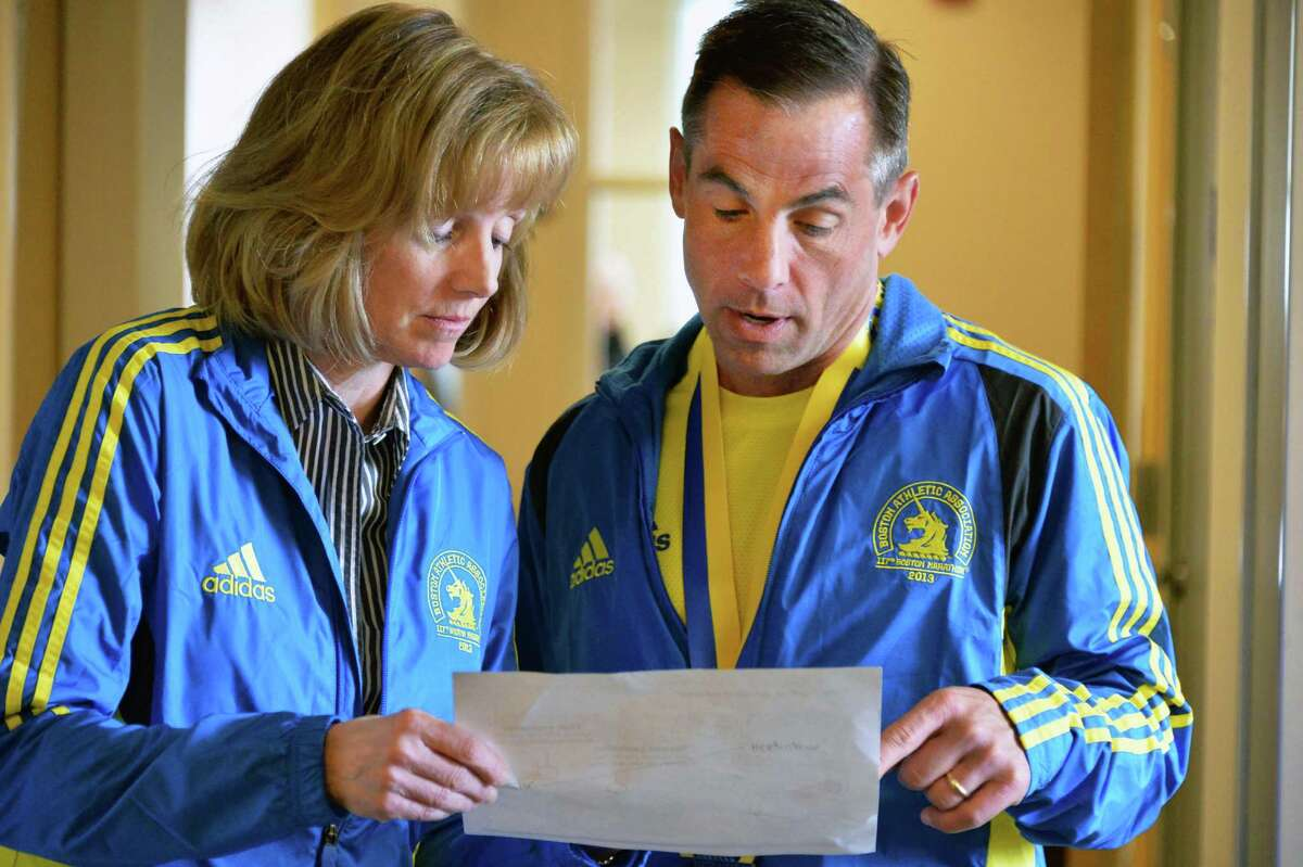 Runners and survivors of yesterday's Boston Marathon Joanne Fitzgerald, left, and Joseph McDonald look over a map of the bombings along the marathon route outside their offices at Union Graduate College in Schenectady, NY Tuesday April 16, 2013. Joanne is vice president of enrollment management and student services and Joseph is vice president of finance and operations. (John Carl D'Annibale / Times Union)