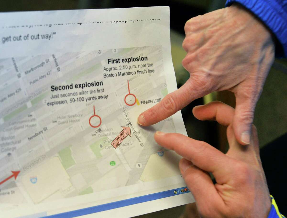 Runners and survivors of yesterday's Boston Marathon Joanne Fitzgerald, left, and Joseph McDonald look over a map of the bombings along the marathon route at their offices at Union Graduate College in Schenectady, NY Tuesday April 16, 2013. (John Carl D'Annibale / Times Union)