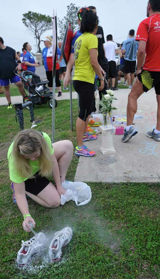 "Gulf Terrace Hike & Bike Trail9310 Phelan Blvd.(File photo) Sarah Zarate sprays a pair of running shoes white that will be ""ghost shoes"" on a memorial that will be left up at the Hike and Bike trail starting point at the soccer complex.  Two running groups, the Sea Rim Striders and the Golden Triangle Strutters held silent runs Tuesday night, in memory of those hurt and killed during the Boston Marathon on Monday, at the Gulf Terrace Hike & Bike trail in Beaumont.  Dave Ryan/The Enterprise"