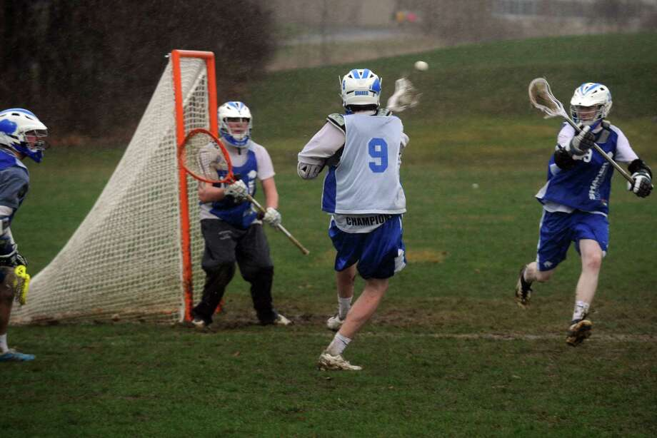 Player Tim Leahey takes a shot on goal during Shaker boy's varsity lacrosse practice on Tuesday April 16, 2013 in Latham N.Y. (Michael P. Farrell/Times Union) Photo: Michael P. Farrell