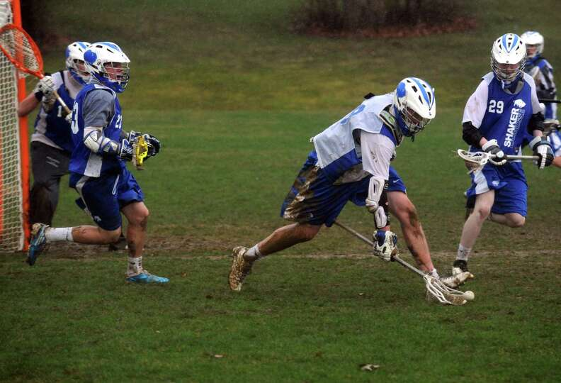Player Tim Leahey, center, during Shaker boy's varsity lacrosse practice on Tuesday April 16, 2013 i