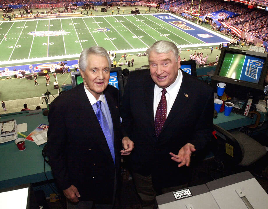 FILE - In this Feb. 3, 2002, file photo, Fox broadcasters Pat Summerall, left, and John Madden stand in the booth at Louisiana Superdome before the NFL Super Bowl XXXVI football game in New Orleans. Fox Sports spokesman Dan Bell said Tuesday, April 16, 2013, that Summerall, the NFL player-turned-broadcaster whose deep, resonant voice called games for more than 40 years, has died at the age of 82. (AP Photo/Ric Feld, File) Photo: Ric Feld