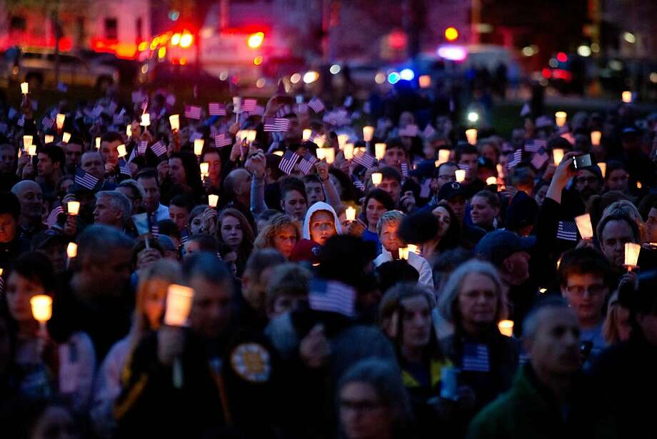 Mourners attend candlelight vigil for Martin Richard at Garvey Park, near Richard's home in the Dorchester section of Boston, on Tuesday, April 16, 2013. Martin is the 8-year-old boy killed in the Boston Marathon bombing. (AP Photo/The New York Times, Josh Haner)  MANDATORY CREDIT;  NYC OUT;  MAGS OUT; NO SALES; TV OUT,  NO ARCHIVE Photo: Josh Haner, Associated Press