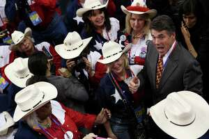 Texas Gov. Rick Perry (R) greets the delegation fron Texas during the Republican National Convention at the Tampa Bay Times Forum on August 28, 2012 in Tampa, Florida. Today is the first full session of the RNC after the start was delayed due to Tropical Storm Isaac.