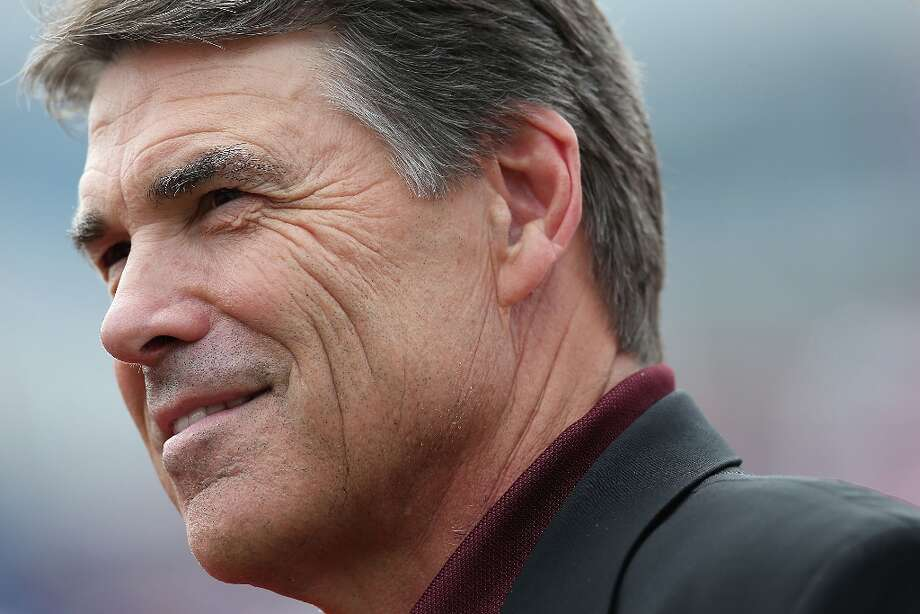 DALLAS, TX - SEPTEMBER 15:  Texas Gov. Rick Perry attends a game between the Texas A&M Aggies and the Southern Methodist Mustangs at Gerald J. Ford Stadium on September 15, 2012 in Dallas, Texas.  (Photo by Ronald Martinez/Getty Images) Photo: Ronald Martinez, Getty Images / 2012 Getty Images