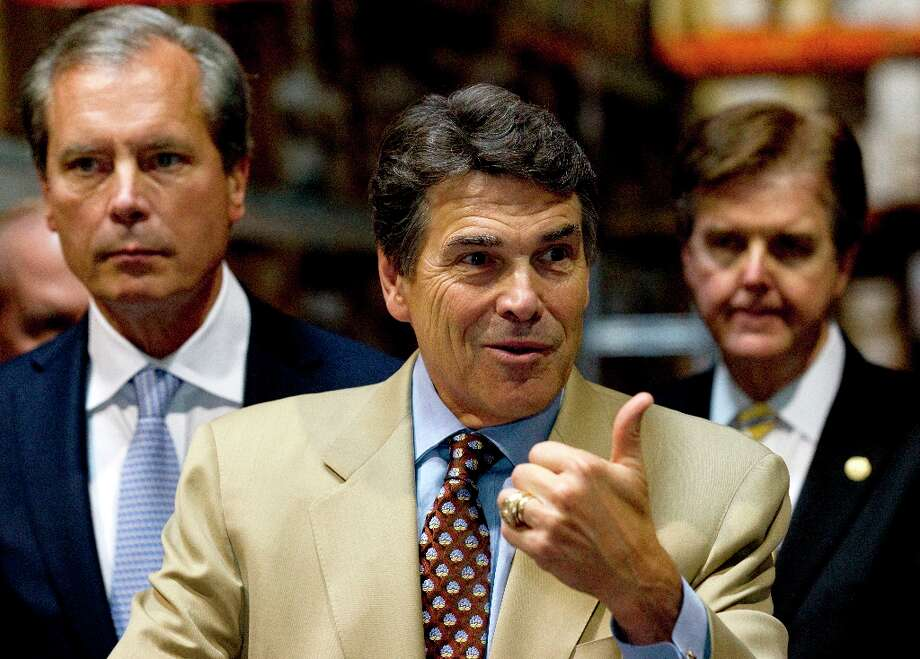 Gov. Rick Perry, center, flanked by Lt. Gov. David Dewhurst, left, and State Sen. Dan Patrick, R-Houston, right, answers questions during a news conference discussing the need for stricter spending limits in Texas on Tuesday, Sept. 25, 2012, in Houston. ( Brett Coomer / Houston Chronicle ) Photo: Brett Coomer, Houston Chronicle / © 2012 Houston Chronicle