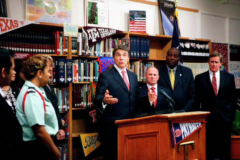 Texas Gov. Rick Perry addresses the media at Thomas Jefferson High School in Dallas, where he announced plans to make higher education more affordable and accessible for students. Perry plans to freeze college tuition for four years and will use outcome-based funding for high schools. (Katie Currid/The Dallas Morning News) Photo: Katie Currid, Staff Photographer / 10015569A
