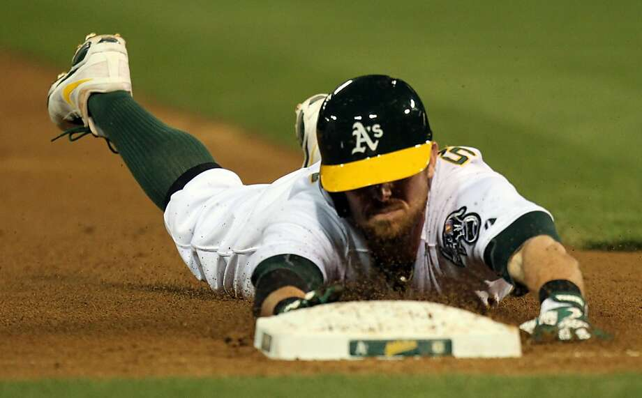 Oakland Athletics Eric Sogard slides safely into 3rd base after hitting a triple in the 3rd inning against the Houston Astros during their MLB baseball game Tuesday, April 16, 2013 in Oakland, Calif. Photo: Lance Iversen, The Chronicle