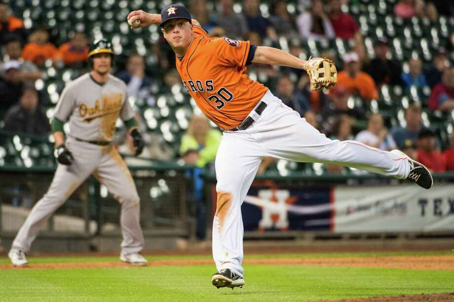 Third baseman Matt Dominguez came to the Astros with a reputation for slick glovework, and he hasn't disappointed. Photo: Smiley N. Pool / © 2013  Smiley N. Pool