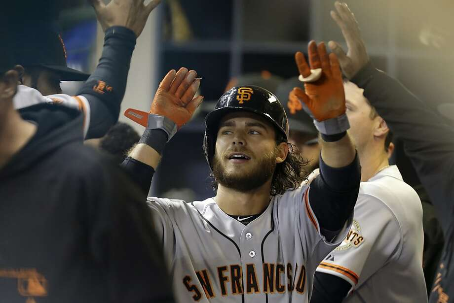 MILWAUKEE, WI - APRIL 16:  Brandon Crawford #42 of the San Francisco Giants celebrates in the dugout after scoring on a hit by Angel Pagan in the top of the third inning against the Milwaukee Brewers at Miller Park on April 16, 2013 in Milwaukee, Wisconsin. (Photo by Mike McGinnis/Getty Images) Photo: Mike McGinnis, Getty Images