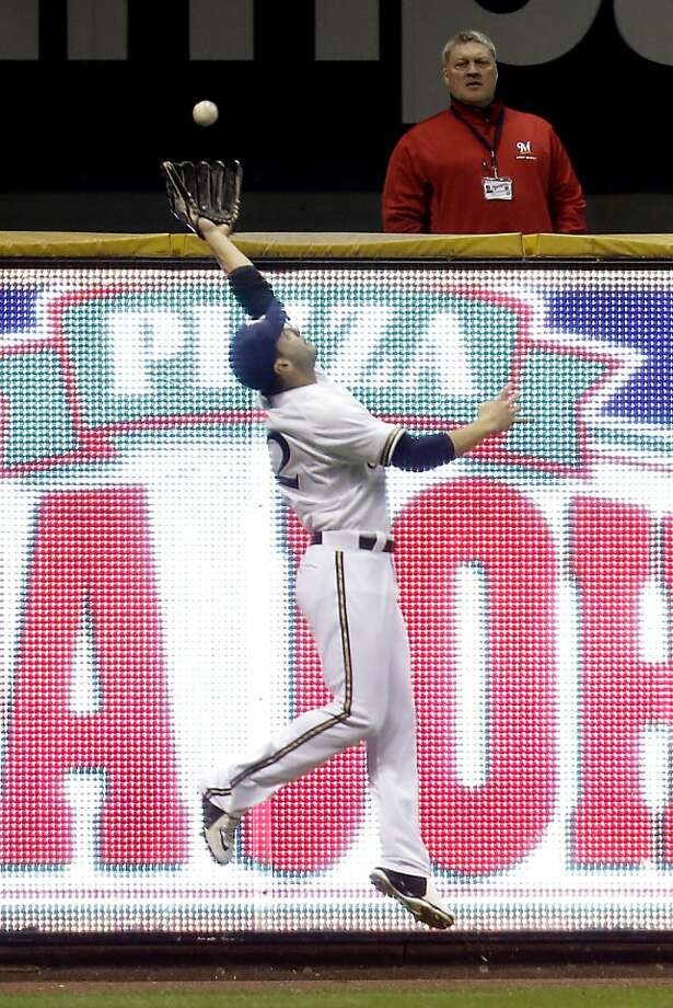 Ryan Braun of the Milwaukee Brewers makes a leaping catch in left field to retire Brandon Belt of the San Francisco Giants in the top of the fifth inning at Miller Park April 16, 2013 in Milwaukee, Wisconsin.  Photo: Mike McGinnis, Getty Images