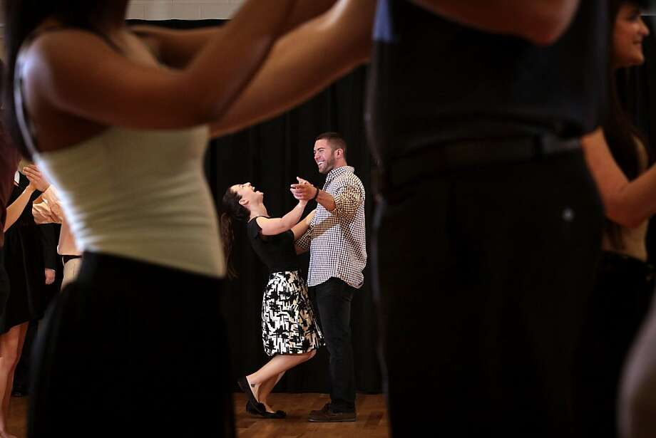 Heather Boyle, 22, and Lance Ippolito, 24, laugh as they learn to dance the rumba on Tuesday, April 16, 2013, at the University of South Florida in Tampa, Fla. Dozens of business students took ballroom dancing lessons on Tuesday. The students are part of the Corporate Mentor Program and they are the first in their families to go to college. The aim of the dancing lessons is to teach them poise and confidence for their future careers. (AP Photo/The Tampa Bay Times, Edmund D. Fountain) TAMPA OUT; CITRUS COUNTY OUT; PORT CHARLOTTE OUT; BROOKSVILLE HERNANDO OUT; USA TODAY OUT; MAGS OUT Photo: Fountain, Edmund D., Associated Press