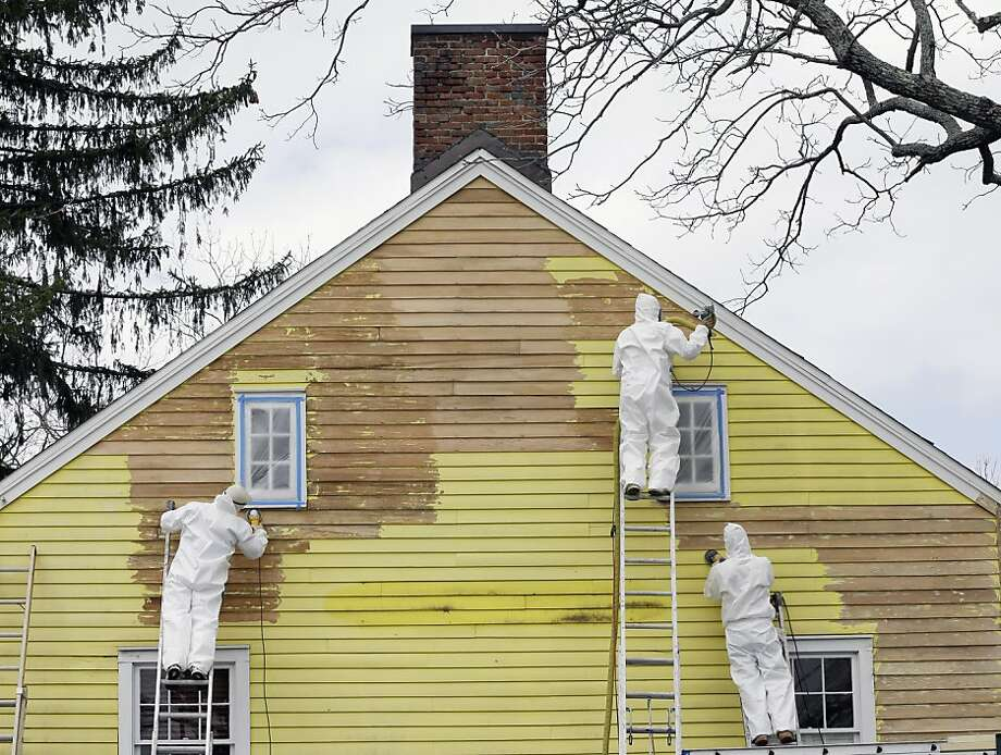 Workers take advantage of the region's mild weather, as they prepare a house to be repainted near New Vernon, N.J., Tuesday, April 16, 2013. (AP Photo/Mel Evans) Photo: Mel Evans, Associated Press