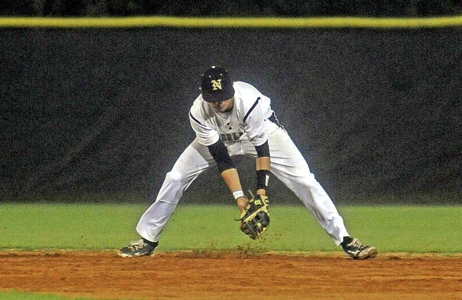 Nederland player Brandon Self, #3, plays a ball off the bounce during the Nederland High School baseball game against Port Neches-Groves High School on Tuesday, April 16, 2013, in Nederland. Photo taken: Randy Edwards/The Enterprise Photo: Randy Edwards