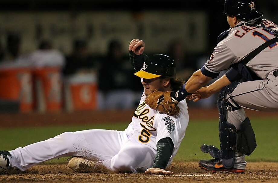 Oakland Athletics catcher John Jaso is tagged out at home plate by Houston Astros Jason Castro in the 5th inning of their MLB baseball game Tuesday, April 16, 2013 in Oakland, Calif. Photo: Lance Iversen, The Chronicle